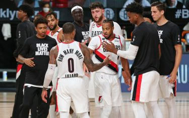 ORLANDO, FL - AUGUST 13: The Portland Trail Blazers celebrate on court after the game against the Brooklyn Nets on August 13, 2020 in Orlando, Florida at AdventHealth Arena at ESPN Wide World of Sports. NOTE TO USER: User expressly acknowledges and agrees that, by downloading and/or using this photograph, user is consenting to the terms and conditions of the Getty Images License Agreement.  Mandatory Copyright Notice: Copyright 2020 NBAE (Photo by David Sherman/NBAE via Getty Images)