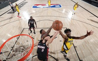 Orlando, FL - AUGUST 14: Kelly Olynyk #9 of the Miami Heat and Alize Johnson #24 of the Indiana Pacers go up for a rebound on August 14, 2020 at AdventHealth Arena at ESPN Wide World of Sports in Orlando, Florida. NOTE TO USER: User expressly acknowledges and agrees that, by downloading and/or using this Photograph, user is consenting to the terms and conditions of the Getty Images License Agreement. Mandatory Copyright Notice: Copyright 2020 NBAE (Photo by David Sherman/NBAE via Getty Images)