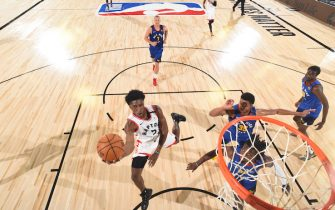 Orlando, FL - AUGUST 14: Stanley Johnson #5 of the Toronto Raptors drives to the basket against the Denver Nuggets on August 14, 2020 at The Field House in Orlando, Florida. NOTE TO USER: User expressly acknowledges and agrees that, by downloading and/or using this Photograph, user is consenting to the terms and conditions of the Getty Images License Agreement. Mandatory Copyright Notice: Copyright 2020 NBAE (Photo by Garrett Ellwood/NBAE via Getty Images)