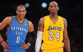 LOS ANGELES, CA - JANUARY 11:  Russell Westbrook #0 of the Oklahoma City Thunder and Kobe Bryant #24 of the Los Angeles Lakers look on during their game at Staples Center on January 11, 2013 in Los Angeles, California. NOTE TO USER: User expressly acknowledges and agrees that, by downloading and/or using this Photograph, user is consenting to the terms and conditions of the Getty Images License Agreement. Mandatory Copyright Notice: Copyright 2013 NBAE (Photo by Noah Graham/NBAE via Getty Images)