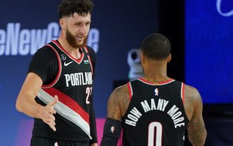 ORLANDO, FL - AUGUST 15: Jusuf Nurkic #27 and Damian Lillard #0 of the Portland Trail Blazers shake hands against the Memphis Grizzlies during the Western Conference Play in Game on August 15, 2020 in Orlando, Florida at The Field House at ESPN Wide World of Sports. NOTE TO USER: User expressly acknowledges and agrees that, by downloading and/or using this photograph, user is consenting to the terms and conditions of the Getty Images License Agreement.  Mandatory Copyright Notice: Copyright 2020 NBAE (Photo by Jesse D. Garrabrant/NBAE via Getty Images)
