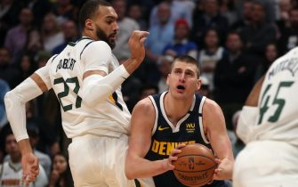 DENVER, COLORADO - JANUARY 30: Nikola Jokic #15 of the Denver Nuggets goes to the basket against Rudy Gobert #27 of the Utah Jazz in the first quarter at the Pepsi Center on January 30, 2020 in Denver, Colorado. NOTE TO USER: User expressly acknowledges and agrees that, by downloading and or using this photograph, User is consenting to the terms and conditions of the Getty Images License Agreement. (Photo by Matthew Stockman/Getty Images)