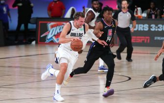ORLANDO, FL - AUGUST 17: Luka Doncic #77 of the Dallas Mavericks drives to the basket against the LA Clippers during Round One, Game One of the NBA Playoffs on August 17, 2020 at AdventHealth Arena in Orlando, Florida. NOTE TO USER: User expressly acknowledges and agrees that, by downloading and/or using this Photograph, user is consenting to the terms and conditions of the Getty Images License Agreement. Mandatory Copyright Notice: Copyright 2020 NBAE (Photo by Joe Murphy/NBAE via Getty Images)