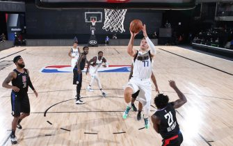 ORLANDO, FL - AUGUST 17: Luka Doncic #77 of the Dallas Mavericks shoots the ball against the LA Clippers during Round One, Game One of the NBA Playoffs on August 17, 2020 at AdventHealth Arena in Orlando, Florida. NOTE TO USER: User expressly acknowledges and agrees that, by downloading and/or using this Photograph, user is consenting to the terms and conditions of the Getty Images License Agreement. Mandatory Copyright Notice: Copyright 2020 NBAE (Photo by Joe Murphy/NBAE via Getty Images)