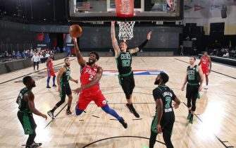 ORLANDO, FL - AUGUST 17: Joel Embiid #21 of the Philadelphia 76ers shoots the ball against the Boston Celtics during Round One, Game One of the NBA Playoffs on August 17, 2020 at The Field House in Orlando, Florida. NOTE TO USER: User expressly acknowledges and agrees that, by downloading and/or using this Photograph, user is consenting to the terms and conditions of the Getty Images License Agreement. Mandatory Copyright Notice: Copyright 2020 NBAE (Photo by Jesse D. Garrabrant/NBAE via Getty Images)