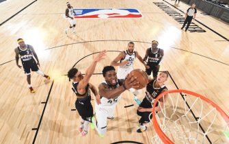 Orlando, FL - AUGUST 17: Donovan Mitchell #45 of the Utah Jazz shoots the ball against the Denver Nuggets during Round One, Game One of the NBA Playoffs on August 17, 2020 in Orlando, Florida at The Field House. NOTE TO USER: User expressly acknowledges and agrees that, by downloading and/or using this Photograph, user is consenting to the terms and conditions of the Getty Images License Agreement. Mandatory Copyright Notice: Copyright 2020 NBAE (Photo by Garrett Ellwood/NBAE via Getty Images)