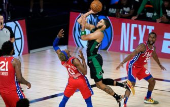 LAKE BUENA VISTA, FLORIDA - AUGUST 17: Jayson Tatum #0 of the Boston Celtics goes up for a shot over Josh Richardson #0 of the Philadelphia 76ers during the second half of Game One of the 2020 NBA Playoffs at AdventHealth Arena at the ESPN Wide World Of Sports Complex on August 17, 2020 in Lake Buena Vista, Florida. NOTE TO USER: User expressly acknowledges and agrees that, by downloading and or using this photograph, User is consenting to the terms and conditions of the Getty Images License Agreement. (Photo by Ashley Landis-Pool/Getty Images)
