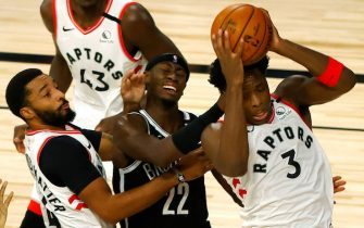 LAKE BUENA VISTA, FLORIDA - AUGUST 19: OG Anunoby #3 of the Toronto Raptors grabs a rebound as Caris LeVert #22 of the Brooklyn Nets draws a foul Norman Powell #24 of the Toronto Raptors of the Toronto Raptors during the second quarter in Game Two of the Eastern Conference First Round during the 2020 NBA Playoffs at The Field House at ESPN Wide World Of Sports Complex on August 19, 2020 in Lake Buena Vista, Florida. NOTE TO USER: User expressly acknowledges and agrees that, by downloading and or using this photograph, User is consenting to the terms and conditions of the Getty Images License Agreement. (Photo by Kevin C. Cox/Getty Images)