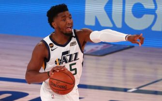 Aug 19, 2020; Lake Buena Vista, Florida, USA; Utah Jazz guard Donovan Mitchell (45) dribbles the basketball against the Denver Nuggets in game two of the first round of the 2020 NBA Playoffs at AdventHealth Arena. Mandatory Credit: Kim Klement-USA TODAY Sports
