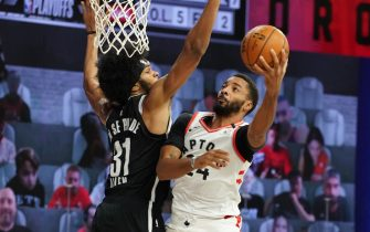 ORLANDO, FL - AUGUST 19: Norman Powell #24 of the Toronto Raptors shoots the ball against the Brooklyn Nets during Round One, Game Two of the NBA Playoffs on August 19, 2020 at the The Field House at ESPN Wide World Of Sports Complex in Orlando, Florida. NOTE TO USER: User expressly acknowledges and agrees that, by downloading and/or using this Photograph, user is consenting to the terms and conditions of the Getty Images License Agreement. Mandatory Copyright Notice: Copyright 2020 NBAE (Photo by Jesse D. Garrabrant/NBAE via Getty Images)