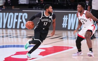 Orlando, FL - AUGUST 17: Garrett Temple #17 of the Brooklyn Nets handles the ball against the Toronto Raptors during Round One, Game One of the NBA Playoffs on August 17, 2020 in Orlando, Florida at AdventHealth Arena. NOTE TO USER: User expressly acknowledges and agrees that, by downloading and/or using this Photograph, user is consenting to the terms and conditions of the Getty Images License Agreement. Mandatory Copyright Notice: Copyright 2020 NBAE (Photo by Joe Murphy/NBAE via Getty Images)