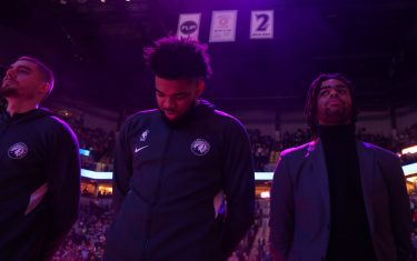 MINNEAPOLIS, MN -  FEBRUARY 8: Karl-Anthony Towns #32 and D'Angelo Russell #0 of the Minnesota Timberwolves stands for the National Anthem during the game against the LA Clippers on February 8, 2020 at Target Center in Minneapolis, Minnesota. NOTE TO USER: User expressly acknowledges and agrees that, by downloading and or using this Photograph, user is consenting to the terms and conditions of the Getty Images License Agreement. Mandatory Copyright Notice: Copyright 2020 NBAE (Photo by David Sherman/NBAE via Getty Images)