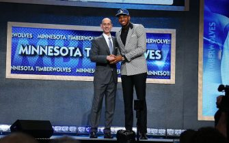 BROOKLYN, NY - JUNE 25: Karl-Anthony Towns shakes hands with NBA Commissioner Adam Silver after being selected number one overall by the Minnesota Timberwolves during the 2015 NBA Draft on June 25, 2015 at Barclays Center in Brooklyn, New York. NOTE TO USER: User expressly acknowledges and agrees that, by downloading and or using this photograph, User is consenting to the terms and conditions of the Getty Images License Agreement. Mandatory Copyright Notice: Copyright 2015 NBAE (Photo by Nathaniel S. Butler /NBAE via Getty Images)