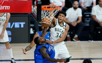 LAKE BUENA VISTA, FLORIDA - AUGUST 20:  Giannis Antetokounmpo #34 scores over Gary Clark #12 of the Orlando Magic during the second half of an NBA basketball first round playoff game on August 20, 2020 in Lake Buena Vista, Florida. NOTE TO USER: User expressly acknowledges and agrees that, by downloading and or using this photograph, User is consenting to the terms and conditions of the Getty Images License Agreement. (Photo by Ashley Landis - Pool/Getty Images)