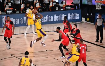 ORLANDO, FL - AUGUST 20: LeBron James #23 of the Los Angeles Lakers passes against the Portland Trail Blazers for Game two of the first round of the 2020 Playoffs as part of the NBA Restart 2020 on August 20, 2020 at Advent Health Arena at ESPN Wide World of Sports Complex in Orlando, Florida. NOTE TO USER: User expressly acknowledges and agrees that, by downloading and/or using this photograph, user is consenting to the terms and conditions of the Getty Images License Agreement.  Mandatory Copyright Notice: Copyright 2020 NBAE (Photo by David Dow/NBAE via Getty Images)