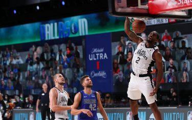 Orlando, FL - AUGUST 21: Kawhi Leonard #2 of the LA Clippers shoots the ball against the Dallas Mavericks during Round One, Game One of the NBA Playoffs on August 21, 2020 in Orlando, Florida at AdventHealth Arena. NOTE TO USER: User expressly acknowledges and agrees that, by downloading and/or using this Photograph, user is consenting to the terms and conditions of the Getty Images License Agreement. Mandatory Copyright Notice: Copyright 2020 NBAE (Photo by Joe Murphy/NBAE via Getty Images)