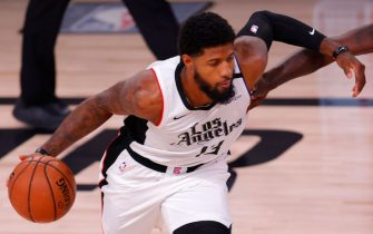 LAKE BUENA VISTA, FLORIDA - AUGUST 21: Paul George (13) of the LA Clippers drives against the Dallas Mavericks in Game Three of the Western Conference First Round during the 2020 NBA Playoffs at AdventHealth Arena at ESPN Wide World Of Sports Complex on August 21, 2020 in Lake Buena Vista, Florida. NOTE TO USER: User expressly acknowledges and agrees that, by downloading and or using this photograph, User is consenting to the terms and conditions of the Getty Images License Agreement. (Photo by Mike Ehrmann/Getty Images)