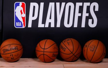 LAKE BUENA VISTA, FLORIDA - AUGUST 17: Basketballs are lined up under the NBA Playoffs logo before the start of a game between the Toronto Raptors and the Brooklyn Nets in Game One of the Eastern Conference First Round during the 2020 NBA Playoffs at AdventHealth Arena at ESPN Wide World Of Sports Complex on August 17, 2020 in Lake Buena Vista, Florida. (Photo by Kevin C. Cox/Getty Images)