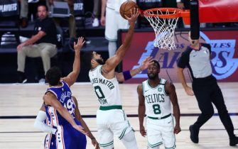 LAKE BUENA VISTA, FLORIDA - AUGUST 23: Jayson Tatum #0 of the Boston Celtics shoots past Raul Neto #19 of the Philadelphia 76ers during the fourth quarter in Game Four of the first round of the playoffs at The Field House at ESPN Wide World Of Sports Complex on August 23, 2020 in Lake Buena Vista, Florida. NOTE TO USER: User expressly acknowledges and agrees that, by downloading and or using this photograph, User is consenting to the terms and conditions of the Getty Images License Agreement. (Photo by Kim Klement-Pool/Getty Images)