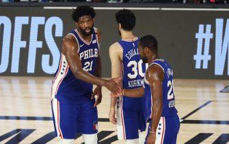 Aug 23, 2020; Lake Buena Vista, Florida, USA; Philadelphia 76ers center Joel Embiid (21) and forward guard Alec Burks (20) and guard Furkan Korkmaz (30)  react during the second quarter against the Boston Celtics in game four of an NBA basketball first-round playoff series at The Field House. Mandatory Credit: Kim Klement-USA TODAY Sports