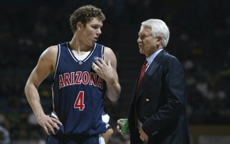 LOS ANGELES - JANUARY 18:  Luke Walton #4 of the University of Arizona Wildcats talks to his head coach Lute Olson during the game against the UCLA Bruins at Pauley Pavilion on January 18, 2003 in Los Angeles, California.  Arizona defeated UCLA 87-52.  (Photo by Jeff Gross/Getty Images)