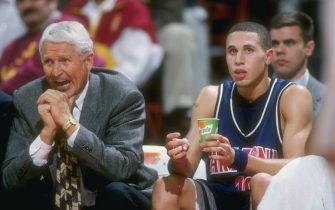 16 Jan 1997:  Arizona Wildcats head coach Lute Olson looks on with guard Mike Bibby during a game against the Southern California Trojans at the Los Angeles Sports Arena in Los Angeles, California.  USC won the game, 71-62. Mandatory Credit: Elsa Hasch  /