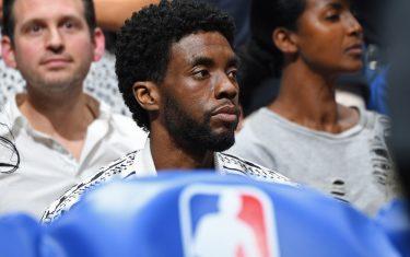LOS ANGELES, CA - OCTOBER 22: Actor Chadwick Boseman attends the game between the LA Clippers and the Los Angeles Lakers on October 22, 2019 at STAPLES Center in Los Angeles, California. NOTE TO USER: User expressly acknowledges and agrees that, by downloading and/or using this Photograph, user is consenting to the terms and conditions of the Getty Images License Agreement. Mandatory Copyright Notice: Copyright 2019 NBAE (Photo by Andrew D. Bernstein/NBAE via Getty Images)