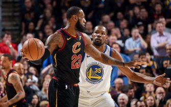 CLEVELAND, OH - JUNE 6: LeBron James #23 of the Cleveland Cavaliers handles the ball against Kevin Durant #35 of the Golden State Warriors during Game Three of the 2018 NBA Finals on June 6, 2018 at Quicken Loans Arena in Cleveland, Ohio. NOTE TO USER: User expressly acknowledges and agrees that, by downloading and or using this Photograph, user is consenting to the terms and conditions of the Getty Images License Agreement. Mandatory Copyright Notice: Copyright 2018 NBAE (Photo by Andrew D. Bernstein/NBAE via Getty Images)