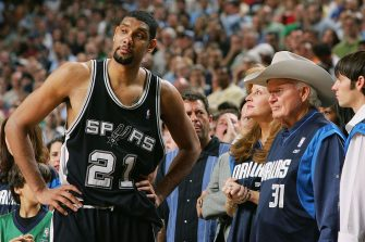 DALLAS, TX - MAY 19:  Tim Duncan #21 of the San Antonio Spurs looks on during the game against the Dallas Mavericks in game six of the Western Conference Semifinals during the 2006 NBA Playoffs at American Airlines Center on May 19, 2006 in Dallas, Texas.  NOTE TO USER: User expressly acknowledges and agrees that, by downloading and/or using this Photograph, user is consenting to the terms and conditions of the Getty Images License Agreement. Mandatory Copyright Notice: Copyright 2006 NBAE  (Photo by Garrett W. Ellwood/NBAE via Getty Images)