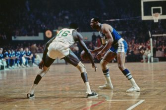 BOSTON, MA - 1966: Elgin Baylor #22 of the Los Angeles Lakers handles the ball against the Boston Celtics circa 1966 at the Boston Garden in Boston, Massachusetts. NOTE TO USER: User expressly acknowledges and agrees that, by downloading and/or using this photograph, user is consenting to the terms and conditions of the Getty Images License Agreement. Mandatory Copyright Notice: Copyright 1966 NBAE (Photo by Dick Raphael/NBAE via Getty Images)