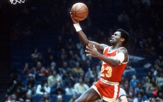 LANDOVER, MD - CIRCA 1977:  Calvin Murphy #23 of the Houston Rockets goes in for a layup against the Washington Bullets during an NBA basketball game circa 1977 at the Capital Centre in Landover, Maryland. Murphy played for the Rockets from 1970-83. (Photo by Focus on Sport/Getty Images)