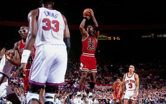 NEW YORK - 1992:  Michael Jordan #23 of the Chicago Bulls shoots a jump shot against Patrick Ewing #33 of the New York Knicks during a game circa 1992 at Madison Square Garden in New York, New York.  NOTE TO USER: User expressly acknowledges that, by downloading and or using this photograph, User is consenting to the terms and conditions of the Getty Images License agreement. Mandatory Copyright Notice: Copyright 1992 NBAE (Photo by Nathaniel S. Butler/NBAE via Getty Images)