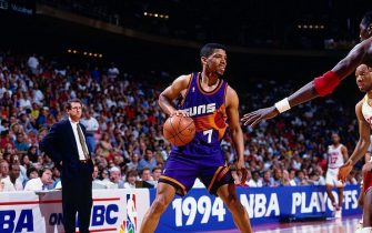 HOUSTON- MAY 21:  Kevin Johnson #7 of the Phoenix Suns looks to make a move in Game Seven of the Western Conference Semifinals against the Houston Rockets during the 1994 NBA Finals at the Summit on May 21, 1994 in Houston, Texas.  The Rockets won 104-94.  NOTE TO USER: User expressly acknowledges that, by downloading and or using this photograph, User is consenting to the terms and conditions of the Getty Images License agreement. Mandatory Copyright Notice: Copyright 1994 NBAE (Photo by Nathaniel S. Butler/NBAE via Getty Images)