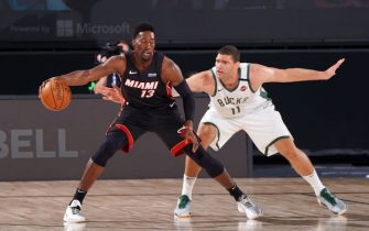 ORLANDO, FL - AUGUST 31: Bam Adebayo #13 of the Miami Heat handles the ball against Brook Lopez #11 of the Milwaukee Bucks during Game One of the Eastern Conference Semifinals of the NBA Playoffs on August 31, 2020 at the The Field House at ESPN Wide World Of Sports Complex in Orlando, Florida. NOTE TO USER: User expressly acknowledges and agrees that, by downloading and/or using this Photograph, user is consenting to the terms and conditions of the Getty Images License Agreement. Mandatory Copyright Notice: Copyright 2020 NBAE (Photo by Jesse D. Garrabrant/NBAE via Getty Images)