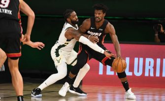 ORLANDO, FL - AUGUST 31: Jimmy Butler #22 of the Miami Heat handles the ball against the Milwaukee Bucks during Game One of the Eastern Conference Semifinals of the NBA Playoffs on August 31, 2020 at the The Field House at ESPN Wide World Of Sports Complex in Orlando, Florida. NOTE TO USER: User expressly acknowledges and agrees that, by downloading and/or using this Photograph, user is consenting to the terms and conditions of the Getty Images License Agreement. Mandatory Copyright Notice: Copyright 2020 NBAE (Photo by Garrett Ellwood/NBAE via Getty Images)