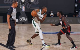 ORLANDO, FL - AUGUST 31: Khris Middleton #22 of the Milwaukee Bucks handles the ball against the Miami Heat during Game One of the Eastern Conference Semifinals of the NBA Playoffs on August 31, 2020 at the The Field House at ESPN Wide World Of Sports Complex in Orlando, Florida. NOTE TO USER: User expressly acknowledges and agrees that, by downloading and/or using this Photograph, user is consenting to the terms and conditions of the Getty Images License Agreement. Mandatory Copyright Notice: Copyright 2020 NBAE (Photo by Jesse D. Garrabrant/NBAE via Getty Images)