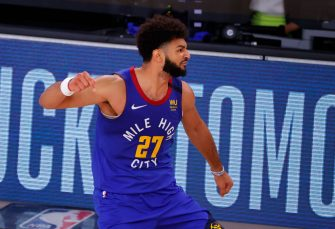 LAKE BUENA VISTA, FLORIDA - AUGUST 30: Jamal Murray #27 of the Denver Nuggets reacts after shooting a three point basket against the Utah Jazz during the fourth quarter in Game Six of the Western Conference First Round during the 2020 NBA Playoffs at AdventHealth Arena at ESPN Wide World Of Sports Complex on August 30, 2020 in Lake Buena Vista, Florida. NOTE TO USER: User expressly acknowledges and agrees that, by downloading and or using this photograph, User is consenting to the terms and conditions of the Getty Images License Agreement. (Photo by Kevin C. Cox/Getty Images)