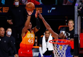 LAKE BUENA VISTA, FLORIDA - AUGUST 30: Donovan Mitchell #45 of the Utah Jazz shoots a three point basket against Jerami Grant #9 of the Denver Nuggets during the fourth quarter in Game Six of the Western Conference First Round during the 2020 NBA Playoffs at AdventHealth Arena at ESPN Wide World Of Sports Complex on August 30, 2020 in Lake Buena Vista, Florida. NOTE TO USER: User expressly acknowledges and agrees that, by downloading and or using this photograph, User is consenting to the terms and conditions of the Getty Images License Agreement. (Photo by Kevin C. Cox/Getty Images)