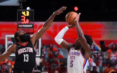 ORLANDO, FL - SEPTEMBER 2: James Harden #13 of the Houston Rockets blocks Luguentz Dort #5 of the Oklahoma City Thunder during Round One, Game Seven of the NBA Playoffs on September 2, 2020 at AdventHealth Arena in Orlando, Florida. NOTE TO USER: User expressly acknowledges and agrees that, by downloading and/or using this Photograph, user is consenting to the terms and conditions of the Getty Images License Agreement. Mandatory Copyright Notice: Copyright 2020 NBAE (Photo by Andrew D. Bernstein/NBAE via Getty Images)
