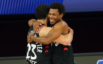 ORLANDO, FL - SEPTEMBER 3: Fred VanVleet #23 of the Toronto Raptors and Kyle Lowry #7 of the Toronto Raptors hug after a game against the Boston Celtics after Game Three of the Eastern Conference Semifinals of the NBA Playoffs on September 3, 2020 at the The Field House at ESPN Wide World Of Sports Complex in Orlando, Florida. NOTE TO USER: User expressly acknowledges and agrees that, by downloading and/or using this Photograph, user is consenting to the terms and conditions of the Getty Images License Agreement. Mandatory Copyright Notice: Copyright 2020 NBAE (Photo by Jesse D. Garrabrant/NBAE via Getty Images)