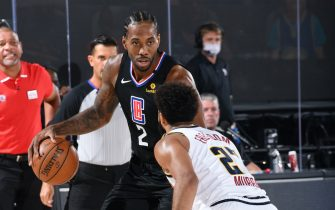 ORLANDO, FL - SEPTEMBER 3: Kawhi Leonard #2 of the LA Clippers handles the ball against the Denver Nuggets during Game One of the Western Conference SemiFinals of the NBA Playoffs on September 3, 2020 at AdventHealth Arena in Orlando, Florida. NOTE TO USER: User expressly acknowledges and agrees that, by downloading and/or using this Photograph, user is consenting to the terms and conditions of the Getty Images License Agreement. Mandatory Copyright Notice: Copyright 2020 NBAE (Photo by Andrew D. Bernstein/NBAE via Getty Images)