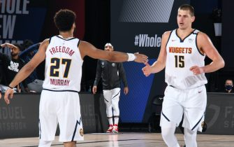 ORLANDO, FL - SEPTEMBER 3: Jamal Murray #27 high-fives Nikola Jokic #15 of the Denver Nuggets during Game One of the Western Conference SemiFinals of the NBA Playoffs on September 3, 2020 at AdventHealth Arena in Orlando, Florida. NOTE TO USER: User expressly acknowledges and agrees that, by downloading and/or using this Photograph, user is consenting to the terms and conditions of the Getty Images License Agreement. Mandatory Copyright Notice: Copyright 2020 NBAE (Photo by Andrew D. Bernstein/NBAE via Getty Images)