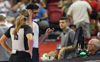 LAS VEGAS, NEVADA - JULY 06:  Green lights on the scorer's table are lit indicating a coach's challenge is under way as referees look at video during a game between the Los Angeles Lakers and the LA Clippers during the 2019 NBA Summer League at the Thomas & Mack Center on July 6, 2019 in Las Vegas, Nevada. The NBA is experimenting with adding a coach's challenge to the current replay review system. NOTE TO USER: User expressly acknowledges and agrees that, by downloading and or using this photograph, User is consenting to the terms and conditions of the Getty Images License Agreement.  (Photo by Ethan Miller/Getty Images)
