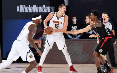 ORLANDO, FL - SEPTEMBER 5: Nikola Jokic #15 of the Denver Nuggets handles the ball during the game against the LA Clippers during Game Two of the Western Conference Semifinals of the NBA Playoffs on September 5, 2020 at The AdventHealth Arena at ESPN Wide World Of Sports Complex in Orlando, Florida. NOTE TO USER: User expressly acknowledges and agrees that, by downloading and/or using this Photograph, user is consenting to the terms and conditions of the Getty Images License Agreement. Mandatory Copyright Notice: Copyright 2020 NBAE (Photo by Andrew D. Bernstein/NBAE via Getty Images)