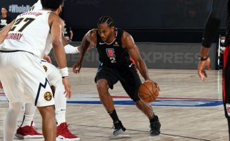 ORLANDO, FL - SEPTEMBER 5: Kawhi Leonard #2 of the LA Clippers handles the ball during the game against the Denver Nuggets during Game Two of the Western Conference Semifinals of the NBA Playoffs on September 5, 2020 at The AdventHealth Arena at ESPN Wide World Of Sports Complex in Orlando, Florida. NOTE TO USER: User expressly acknowledges and agrees that, by downloading and/or using this Photograph, user is consenting to the terms and conditions of the Getty Images License Agreement. Mandatory Copyright Notice: Copyright 2020 NBAE (Photo by Andrew D. Bernstein/NBAE via Getty Images)