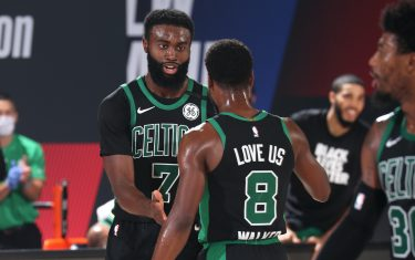 ORLANDO, FL - SEPTEMBER 7: Jaylen Brown #7 high-fives Kemba Walker #8 of the Boston Celtics during Game Five of the Eastern Conference SemiFinals of the NBA Playoffs on September 7, 2020 at The Field House in Orlando, Florida. NOTE TO USER: User expressly acknowledges and agrees that, by downloading and/or using this Photograph, user is consenting to the terms and conditions of the Getty Images License Agreement. Mandatory Copyright Notice: Copyright 2020 NBAE (Photo by Nathaniel S. Butler/NBAE via Getty Images)