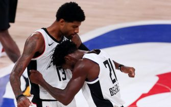 LAKE BUENA VISTA, FLORIDA - SEPTEMBER 07: Paul George #13 of the LA Clippers and Patrick Beverley #21 of the LA Clippers react after their win against the Denver Nuggets in Game Three of the Western Conference Second Round during the 2020 NBA Playoffs at AdventHealth Arena at the ESPN Wide World Of Sports Complex on September 07, 2020 in Lake Buena Vista, Florida. NOTE TO USER: User expressly acknowledges and agrees that, by downloading and or using this photograph, User is consenting to the terms and conditions of the Getty Images License Agreement.  (Photo by Mike Ehrmann/Getty Images)