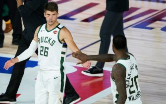 LAKE BUENA VISTA, FLORIDA - AUGUST 24: Kyle Korver #26 of the Milwaukee Bucks celebrates with teammate Marvin Williams #20 after an NBA basketball first round playoff game against the Orlando Magic Monday at The Field House at ESPN Wide World Of Sports Complex on August 24, 2020 in Lake Buena Vista, Florida. NOTE TO USER: User expressly acknowledges and agrees that, by downloading and or using this photograph, User is consenting to the terms and conditions of the Getty Images License Agreement. (Photo by Ashley Landis-Pool/Getty Images)