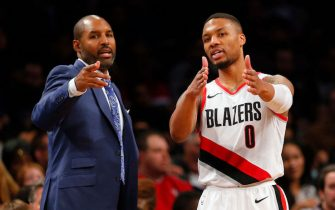 NEW YORK, NY - NOVEMBER 24:  Assistant Coach David Vanterpool of the Portland Trail Blazers talks with Damian Lillard #0 of the Trail Blazers during a break in the action in an NBA basketball game against the Brooklyn Nets on November 24,2017 at Barclays Center in the Brooklyn borough of New York City. Portland won 127-125. NOTE TO USER: User expressly acknowledges and agrees that, by downloading and/or using this Photograph, user is consenting to the terms and conditions of the Getty License agreement. Mandatory Copyright Notice (Photo by Paul Bereswill/Getty Images)