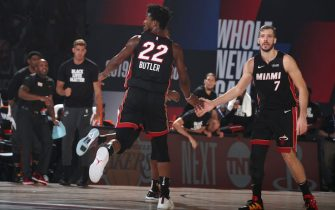 ORLANDO, FL - SEPTEMBER 8: Jimmy Butler #22 high-fives Goran Dragic #7 of the Miami Heat during Game Five of the Eastern Conference SemiFinals of the NBA Playoffs on September 8, 2020 at The Field House in Orlando, Florida. NOTE TO USER: User expressly acknowledges and agrees that, by downloading and/or using this Photograph, user is consenting to the terms and conditions of the Getty Images License Agreement. Mandatory Copyright Notice: Copyright 2020 NBAE (Photo by Nathaniel S. Butler/NBAE via Getty Images)